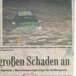 Badische Zeitung mit Polizeiauto im Wasser